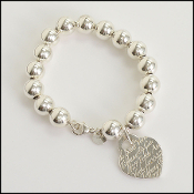 Tiffany & Co. Large Beaded Sterling N.Y. Notes Heart Bracelet